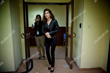 Anna Chapman Russian Anna Chapman, foreground, who was deported from the U.S. on charges of espionage, walks at a backstage as she prepares to display a creations by I Love Fashion, France, during Fall-Winter 2012 - 2013 collection at Mercedes-Benz Fashion Week in Moscow, Russia