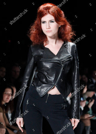 Anna Chapman, who was deported from the U.S. on charges of espionage, displays a creations by I Love Fashion during Mercedes-Benz Fashion Week in Moscow, Russia