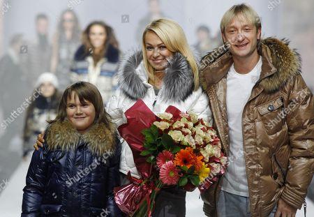Yevgeny Plyushchenko,Yana Rudkovskaya Russian Olympic skater Yevgeny Plyushchenko, right, and producer Yana Rudkovskaya, center, display a creations Odri Fashion house during Fashion Week in Moscow, Russia