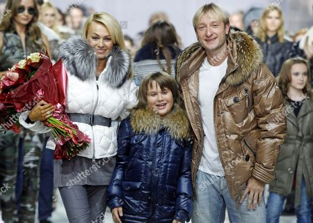 Yevgeny Plyushchenko,Yana Rudkovskaya Russian Olympic skater Yevgeny Plyushchenko, right, and producer Yana Rudkovskaya, left, display a creations Odri Fashion house during Fashion Week in Moscow, Russia