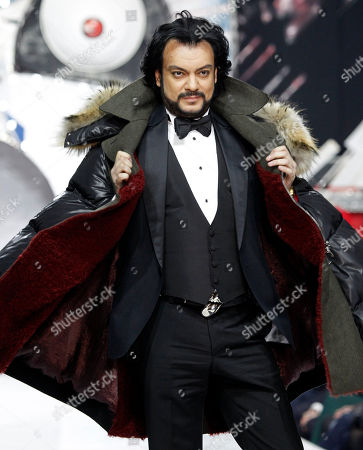 Russian singer Philipp Kirkorov displays a creations by Russian designer Shiyan during Fashion Week in Moscow, Russia
