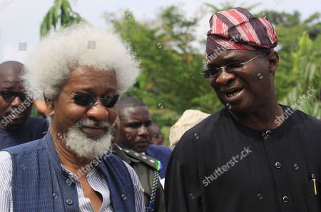 Nobel Laureate professor Wole Soyinka, left, and Babatunde Raji Fashola, right, Lagos state Governor attends the Black heritage festival at the freedom park in Lagos, Nigeria on . Lagos is hosting its annual Lagos Black Heritage Festival this week, which this year includes a look at relations between Nigeria and Italy, a popular spot with young migrant workers from Africa's most populous nation