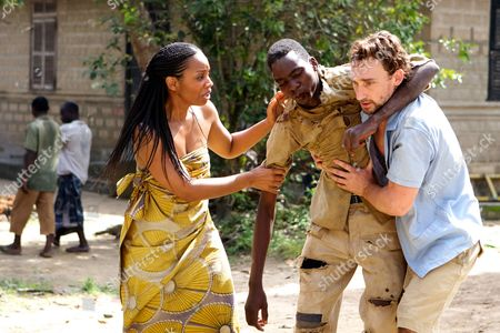 """In this Thursday, May, 17. 2012 photo released by Yellow sun ltd, unidentified actors act in a film ''Half of a yellow sun'' an adaptation of novelist Chimamanda Ngozi Adichie's book, in Calabar, Nigeria. Nigerian censors are effectively banning the film """"Half of a Yellow Sun"""" and will not even say why, the Nigerian-British producers told The Associated Press Thursday amid suspicions that censors fear it could rouse tribal rivalries. The National Film and Video Censor Board insisted it has not banned the movie but delayed its registration over """"some unresolved issues which have to be sorted out."""" The movie's Nigeria premiere was set for last Friday. Invitations had been sent out and the film was to play in every cinema in the country. On Thursday, the board told the distributors that the film had not yet passed the registration process.""""No the film hasn't been banned but we can't show it, which technically is a ban,"""" Biyi Bandele said in a telephone interview from his home in London, where the movie placed among the 10 most popular at cinemas over the Easter weekend. It stars Oscar nominee Chiwetel Ejiofor and Thandie Newton and is an adaptation of the book by prize-winning novelist Chimamanda Ngozi Adichie"""