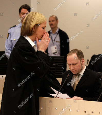Stock Image of Prosecutor Inga Bejer Engh, left, reacts in front of accused Norwegian Anders Behring Breivik at the courtroom, . in Oslo, Norway. The terror trial against the anti-Muslim fanatic Breivik, who has confessed to killing 77 people in Norway, starts amid worries that he will use the proceedings to showcase his radical views. After opening statements, Anders Behring Breivik is set to testify for five days, explaining why he set off a bomb in central Oslo, killing eight, and then shot to death 69 people, mostly teenagers, at a Labor Party youth camp on Utoya island, outside the Norwegian capital
