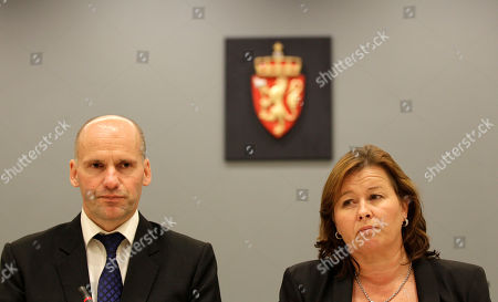Stock Image of Geir Lippestad, left, and Vibeke Hein, the lawyers of Anders Behring Breivik, attend a news conference inside the courtroom, following the first day of his trial in Oslo, Norway, . With a defiant closed-fist salute, Breivik admitted Monday to a bomb-and-shooting massacre that killed 77 people in Norway but pleaded not guilty to criminal charges, saying he was acting in self-defense
