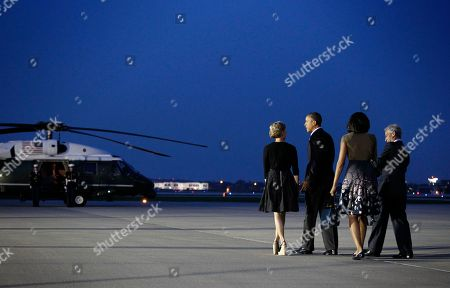 Barack Obama, Michelle Obama, Amy Rule, Rahm Emanuel President Barack Obama and first lady Michelle Obama walk to Marine One helicopter with Chicago Mayor Rahm Emanuel, far right, and wife Amy Rule, far left, during their arrival at O'Hare International airport in Chicago, Saturday, May, 19, 2012. Obama traveled to Chicago to host the two-day NATO summit