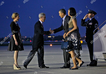 Barack Obama, Michelle Obama, Amy Rule, Rahm Emanuel President Barack Obama and first lady Michelle Obama are greeted by Chicago Mayor Rahm Emanuel and wife Amy Rule, during their arrival at O'Hare International airport in Chicago, Saturday, May, 19, 2012. Obama traveled to Chicago to host the two-day NATO summit