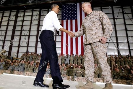 Barack Obama, John Allen Marine Gen. John R. Allen, right, commander of the International Security Assistance Force and U.S. Forces Afghanistan, introduces President Barack Obama before he addresses troops at Bagram Air Field, Afghanistan. Obama's rock-star-like reception at Berlin's Victory Column in the summer of 2008 was a high point of a wildly successful European campaign tour. Those high European expectations have turned into disappointment, largely because of the continued U.S. military presence in Iraq and Afghanistan and Obama's failure to close Guantanamo Bay in the face of vehement congressional opposition