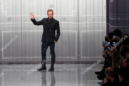 Stock Photo of Designer Bill Gayten acknowledges applause after his show for Christian Dior as part of the Fall-Winter, ready-to-wear 2013 fashion collection, during Paris Fashion week