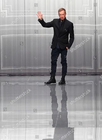 Stock Image of Designer Bill Gayten acknowledges applause after his show for Christian Dior as part of the Fall-Winter, ready-to-wear 2013 fashion collection, during Paris Fashion week