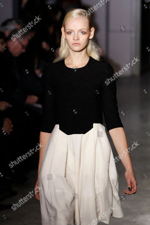 A model wears a creation from designer Martine Sitbon for Rue Du Mail as part of the Fall-Winter, ready-to-wear 2013 fashion collection, during Paris Fashion week