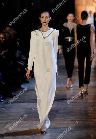 Models wear creations from Italian designer Stefano Pilati for Yves Saint Laurent as part of the Fall-Winter, ready-to-wear 2013 fashion collection, during Paris Fashion week