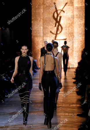 A model wears a creation from Italian designer Stefano Pilati for Yves Saint Laurent as part of the Fall-Winter, ready-to-wear 2013 fashion collection, during Paris Fashion week