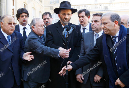 Dalil Boubakeur, Richard Prasquier, Gilles Bernheim, Joel Mergui, Mohamed Moussaoui From left foreground, Paris Mosque rector Dalil Boubakeur, Richard Prasquier, president of the Representative Council of French Jewish Institutions, Grand Rabbi of France Gilles Bernheim, France's Jewish central Consistory President Joel Mergui, and France Muslim President Mohamed Moussaoui share a microphone after a meeting with representatives of French Jewish and Muslim communities at the Elysee Palace in Paris . Sarkozy met the representatives the day after a gunman on a motorbike opened fire Monday at a Jewish school in the French city of Toulouse, southwestern France, killing a rabbi and his two young sons as they waited for a bus, then chased down a 7-year-old girl, shooting her dead at point-blank range. It was the latest in a series of attacks on minorities that have raised fears of a racist killer on the loose
