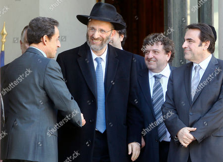 Nicolas Sarkozy, Joel Mergui, Gilles Bernheim France's President Nicolas Sarkozy, left, shakes hands with Grand Rabbi of France Gilles Bernheim as France's Jewish central Consistory President Joel Mergui, right, looks, after a meeting with representatives of French Jewish and Muslim communities at the Elysee Palace in Paris . Sarkozy met the representatives the day after a gunman on a motorbike opened fire Monday at a Jewish school in the French city of Toulouse, southwestern France, killing a rabbi and his two young sons as they waited for a bus, then chased down a 7-year-old girl, shooting her dead at point-blank range. It was the latest in a series of attacks on minorities that have raised fears of a racist killer on the loose