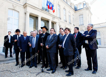 Nicolas Sarkozy, Joel Mergui, Gilles Bernheim France's Jewish central Consistory President Joel Mergui, center right, flanked with France's Grand Rabbi Gilles Bernheim, centre left, addresses the media after a meeting with France's President Nicolas Sarkozy and representatives of French Jewish and Muslim communities at the Elysee Palace in Paris . Sarkozy met the representatives the day after a gunman on a motorbike opened fire Monday at a Jewish school in the French city of Toulouse, southwestern France, killing a rabbi and his two young sons as they waited for a bus, then chased down a 7-year-old girl, shooting her dead at point-blank range. It was the latest in a series of attacks on minorities that have raised fears of a racist killer on the loose