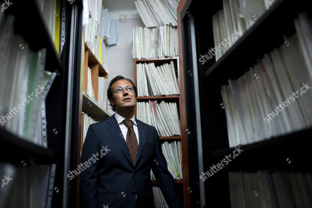 Luis Sequeira Fernandes, a solicitor who runs one of Portugal's biggest bailiff offices, stands among thousands of processes files in one of the storage rooms of his firm in Alcochete, outside Lisbon, . Fernandes says that when his staff, acting on court orders, pursue assets to convert to cash they are increasingly finding that debtors have nothing left to confiscate. Lenders demanded debt-reducing austerity measures have helped pitch the country into a steep decline, with a second straight year of worsening recession, and record unemployment, prompting the plight of personal bankruptcy for many Portuguese families