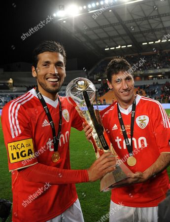 Benfica's Ezequiel Garay, left, from Argentina and Joan Capdevila, from Spain, hold the trophy after defeating Gil Vicente 2-1 in their Portuguese League Cup final soccer at the Cidade de Coimbra stadium, in Coimbra, Portugal