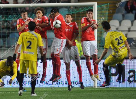 Benfica's Nicolas Gaitan from Argentina, Axel Witsel from Belgium, Oscar Cardozo from Paraguay, Nemanja Matic from Serbia and Joan Capdevila from Spain, from left to right, jump for a free kick from Gil Vicente's Cesar Peixoto, right, during their Portuguese League Cup final soccer match at the Cidade de Coimbra stadium, in Coimbra, Portugal, . Benfica won 2-1