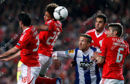 Benfica's Axel Witsel, second left, from Belgium, Joan Capdevila, left, from Spain, Javi Garcia, also from Spain, and Jardel Vieira, second right, from Brazil, fight for a high ball with Porto's Marc Janko, center, from Austria, during their Portuguese League Cup semifinal soccer match at Benfica's Luz stadium in Lisbon, . Benfica won 3-2 and will play the final