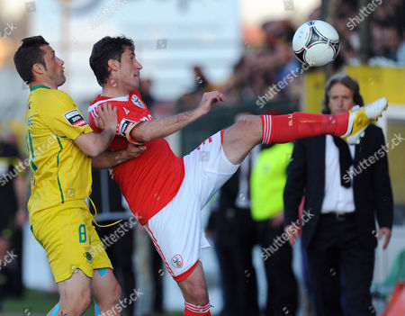 Benfica's Joan Capdevila, from Spain, challenges Pacos Ferreira's Manuel Jose, left, in a Portuguese League soccer match at Mata Real stadium in Pacos de Ferreira, Portugal