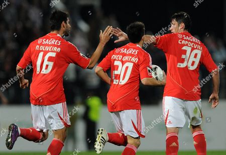 Benfica's Nicolas Gaitan, center, from Argentina celebrates with Joan Capdevila, from Spain, and Nelson Oliveira, left, after scoring the equalizer goal against Pacos Ferreira in a Portuguese League soccer match at Mata Real stadium in Pacos de Ferreira, Portugal