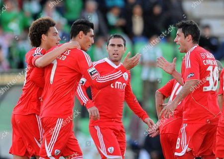 Benfica's Oscar Cardozo, second left, from Paraguay, celebrates with Axel Witsel from Belgium, Bruno Cesar from Brazil and Joan Capdevila from Spain, from left to right, after scoring their team second goal against Rio Ave in a Portuguese League soccer match, in Vila do Conde, Portugal