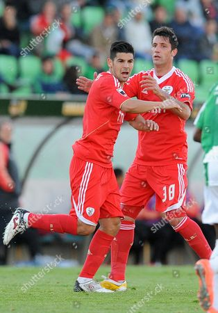 Benfica's Manuel 'Nolito' Agudo, left, and Joan Capdevila, both from Spain, celebrate after scoring the equalizer goal against Rio Ave in a Portuguese League soccer match, in Vila do Conde, Portugal