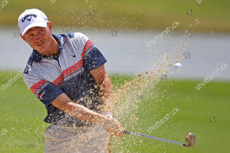 Stock Image of Derek Lamely US' Derek Lamely shoots from a bunker on the eighth hole during the first round of the Puerto Rico Open PGA golf tournament in Rio Grande, Puerto Rico