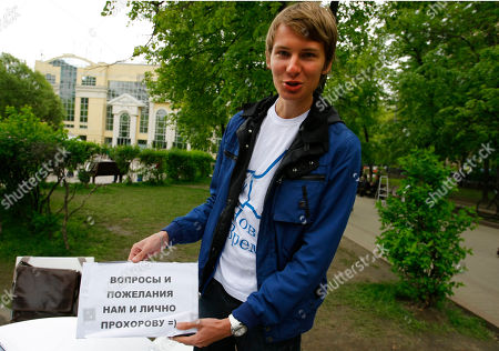 """Alexey Fomin Alexey Fomin, a 19-year-old supporter of former presidential candidate Mikhail Prokhorov, holds a poster reads as """"Questions and comments to us personally, and Prokhorov"""" as he collects protesters' questions and requests for Prokhorov at a plaza near the monument of Kazakh poet Abai Kunanbaev in the opposition camp at the Chistiye Prudy, or Clean Ponds in Moscow, Russia, . A hundred people have occupied a plaza on a leafy boulevard in central Moscow for six days, handing out leaflets, collecting signatures for petitions, reading up for exams and sleeping on yoga mats at night. The movement which came to be known as Occupy Abay in reference to the nearby monument of a great Kazakh poet proves that public discontent with Vladimir Putin's third term in office is not waning, but people are getting increasingly frustrated with authorities who remain deaf to their grievances"""