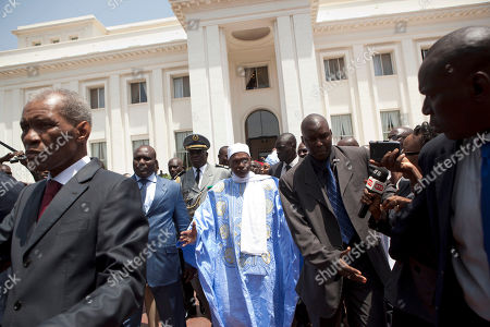 Abdoulaye Wade Senegal's outgoing President Abdoulaye Wade, center, leaves the presidential palace, ceding its occupancy to newly inaugurated leader Macky Sall, not pictured, in Dakar, Senegal . Sall took the oath of office Monday in a ceremony held one week after the country's longtime incumbent conceded defeat only hours after polls closed. The presidential runoff vote solidified the country's reputation as one of the few mature democracies in western Africa, where the unpopular president was ousted at the ballot box instead of a coup