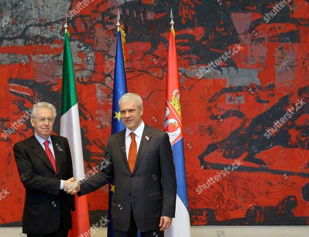 Mario Monti, Boris Tadic Italian Prime Minister Mario Monti, left, shakes hands with Serbian President Boris Tadic, in Belgrade, Serbia, . The second political and business summit Serbia-Italy takes place in Belgrade on March 8, with the participation of Serbian President Boris Tadic and the two countries' prime ministers, Mirko Cvetkovic and Mario Monti