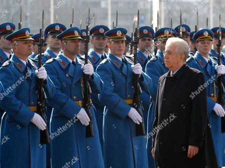 Mario Monti Italian Prime Minister Mario Monti, reviews a guard of honour in Belgrade, Serbia, . The second political and business summit Serbia-Italy takes place in Belgrade on March 8, with the participation of Serbian President Boris Tadic and the two countries' prime ministers, Mirko Cvetkovic and Mario Monti