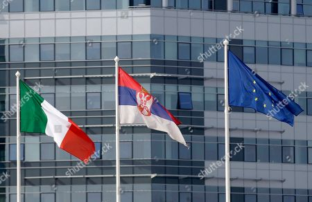 Italian, left, European Union, center, and the Serbian flag fly in front of the Serbia Palace in Belgrade, Serbia, . The second political and business summit Serbia-Italy takes place in Belgrade on March 8, with the participation of Serbian President Boris Tadic and the two countries' prime ministers, Mirko Cvetkovic and Mario Monti