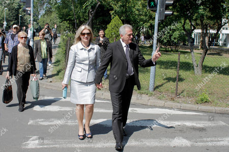 Tomislav Nikolic, Dragica Nikolic Tomislav Nikolic, center, the nationalist Serbian Progressive Party leader and presidential candidate, and his wife, Dragica, left, leave a polling station after they have cast their votes at the presidential runoff elections in Belgrade, Serbia, . Serbians voted Sunday in a presidential runoff election that pits pro European Union Boris Tadic against nationalist Tomislav Nikolic who wants closer ties with Russia and is threatening protests if he loses because of alleged ballot rigging