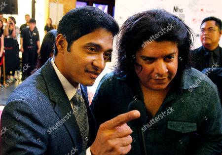 Bollywood actor Shreyas Talpade, left, and director Sajid Khan, arrive for Bollywood's film Housefull 2 world premiere in Singapore