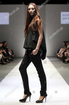 A model presents a creation by German designer Esther Perbandt at the Audi Fashion Festival, in Singapore. The annual fashion festival showcases works of top and emerging designers as part of efforts to promote the city-state as a fashion hub