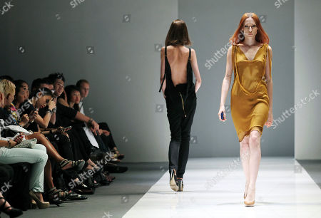 Models present creations by German designer Esther Perbandt at the Audi Fashion Festival, in Singapore. The annual fashion festival showcases works of top and emerging designers as part of efforts to promote the city-state as a fashion hub