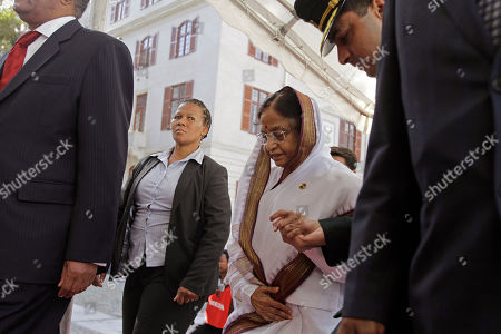 Pratibha Devisingh Patil A security woman, second left, looks on as Indian President Pratibha Patil arrives at Parliament in Cape Town, South Africa, . Patil is on an official state visit to the country