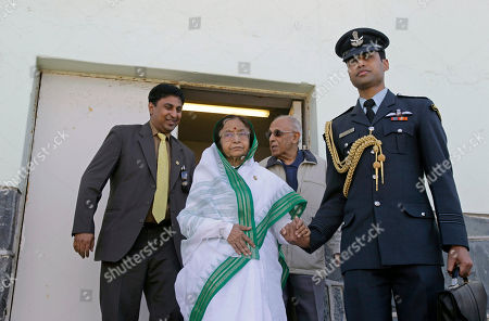 Pratibha Patil Indian President Pratibha Patil, center, walks inside Robben Island prison with the assistance of a Indian officer, right, situated near Cape Town, South Africa, . Patil is on an official state visit to the country