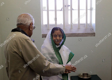 Pratibha Patil, Ahmed Kathrada Indian President Pratibha Patil, center, talks to former South African political prisoner Ahmed Kathrada, left, as they stand inside the cell of ormer South African President Nelson Mandela on Robben Island situated near Cape Town, South Africa, . Patil is on an official state visit to the country