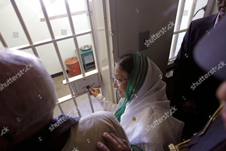 Pratibha Patil, Ahmed Kathrada Indian President Pratibha Patil, center, talk to former South African political prisoner Ahmed Kathrada, left, as she unlock the cell of former South African President Nelson Mandela on Robben Island situated near Cape Town, South Africa, . Patil is on an official state visit to the country