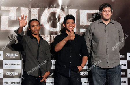 "Iko Uwais, Yayan Ruhian, Gareth Evans Indonesian actor Iko Uwais, center, Yayan Ruhian, left, and Welsh director Gareth Evans, right, pose during a press conference to promote their movie ""The Raid: Redemption"" in Seoul, South Korea"