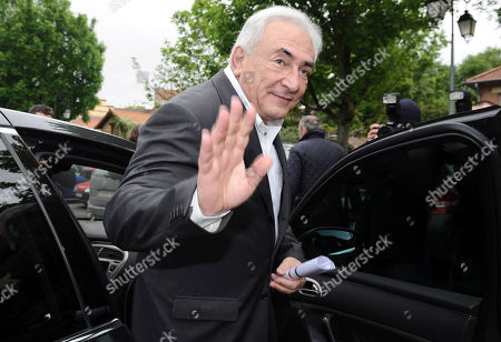 """Dominique Strauss-Kahn Former International Monetary Fund leader Dominique Strauss-Kahn waves as he leaves a polling station after voting for the second round of the French presidential elections in Sarcelles, north of Paris. Strauss-Kahn is suing the hotel housekeeper who accused him of sexually assaulting her, saying she seriously damaged his reputation with what he calls a bogus allegation. He said in court papers filed Monday, May 14, that the Guinean-born Nafissatou Diallo made a """"malicious and wanton false accusation"""" when she said he assaulted her one year ago after she arrived to clean his hotel suite"""
