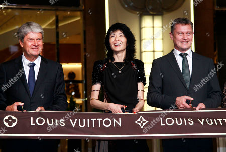 Yves Carcelle, Maggie Cheung, Jean-Baptiste Debains Chairman and CEO of Louis Vuitton Malletier, Yves Carcelle, left, Hong Kong actress Maggie Cheung, center, and President of Louis Vuitton Asia Pacific, Jean-Baptiste Debains cut the ceremonial ribbon during the opening of their grand boutique shop in the Taipei 101 building in Taipei, Taiwan