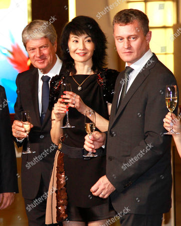 Yves Carcelle, Maggie Cheung, Jean-Baptiste Debains Chairman and CEO of Louis Vuitton Malletier, Yves Carcelle, left, Hong Kong actress Maggie Cheung, center, and President of Louis Vuitton Asia Pacific, Jean-Baptiste Debains enjoy a toast during the opening of their grand boutique shop in the Taipei 101 building in Taipei, Taiwan