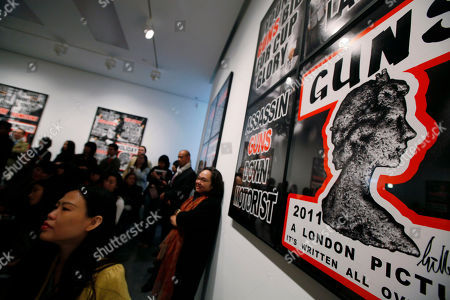 Visitors attend the press conference of British artists Gilbert & George in the White Cube gallery in Hong Kong. In the past decade, Hong Kong's art scene has mushroomed thanks to soaring numbers of wealthy mainland Chinese and other Asians who have developed a taste for collecting. Big names like London's White Cube and Larry Gagosian of the U.S. have opened local outposts of their art dealing empires while numerous lesser-known galleries have also sprouted up over the past decade