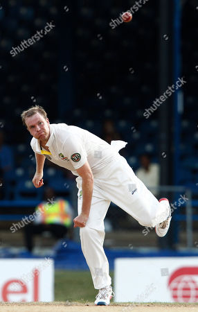Stock Picture of Australia's Michael Beer bowls during the second day of their second cricket Test match against West Indies in Port of Spain, Trinidad
