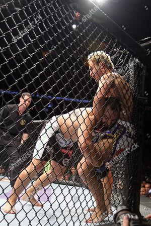 Johny Hendricks, Josh Koscheck Johny Hendricks pushes Josh Koschek against the cage during their bout at UFC on Fox at the Izod Center in E. Rutherford, NJ on . Hendricks won via split decision