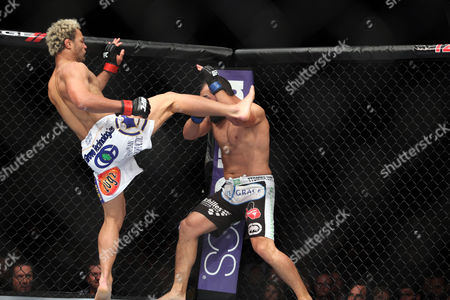 Johny Hendricks, Josh Koscheck Johny Hendricks takes a kick from Josh Koschek during their bout at UFC on Fox at the Izod Center in E. Rutherford, NJ on . Hendricks won via split decision